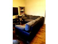 Corner sofa with bed and storage compartment