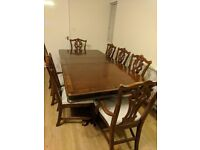 Extendable wooden dining table with 8 chairs