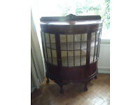Antique mahogany bow fronted glass display cabinet