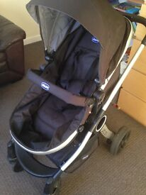 Chicco urban travel system, includes car seat and base for car, black and grey.