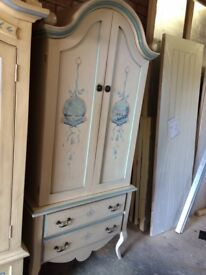 Hand crafted and painted wardrobe with drawers in base