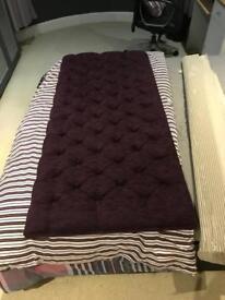 Double bed, deep purple headboard