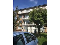 FIRST FLOOR FLAT WITH BALCONY PRIVATE PARKING AND COMMUNAL GARDEN