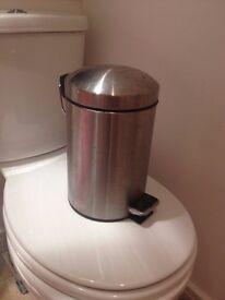 Silver IKEA bin for bathroom
