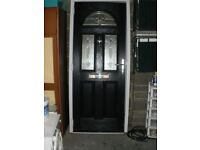 Dark blue composite door.