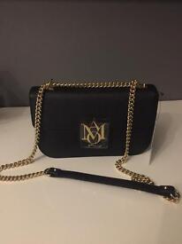 Genuine Alexander McQueen insignia bag