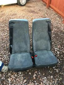 Double seat with belts