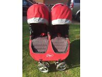 Baby Jogger City Mini double pushchair in red/grey. Good condition.