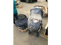Oyster Max travel system. Comes with rain cover for the carry cot and pushchair with accessories.