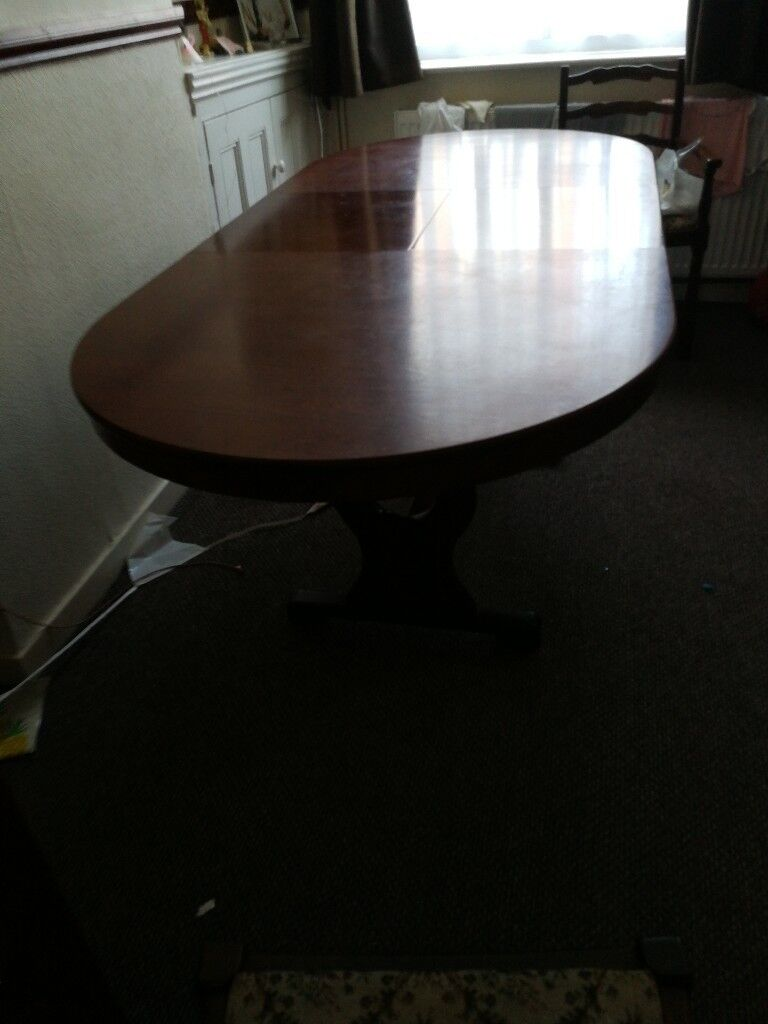 6 chairs and extending solid wood table