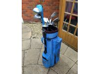 Old used golf clubs and bag
