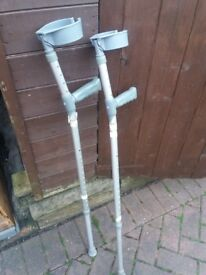 Pair of adjustable crutches