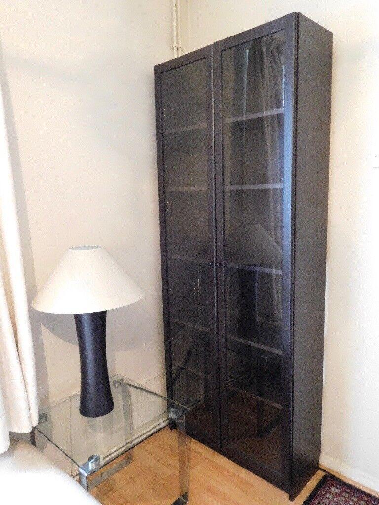 Dark Wood Effect Bookshelf Cabinet With Glass Doors In Putney