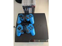 Sony Playstation 3 (PS3) slim with controllers and games