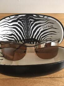 Beautiful genuine Roberto Cavalli sunglasses with original case. Lenses have a brown tint.