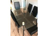 *** Large glass table and 6 black chairs ***