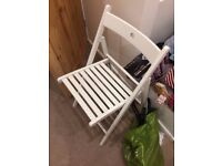 White fold up wooden chair