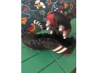 Rugby boots and scrum cap