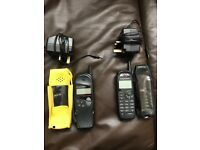 2 Vintage Motorola mobile phones with chargers.