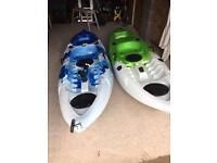 Canoes x2 sit on kayak