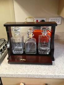 Tantalus wooden with 3 decanters