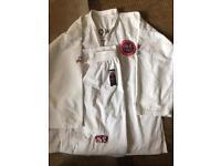 Two TAEKWONDO-DO GTF suits, one black, one white size 170