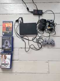 Sony ps2 slim, plus controllers and games