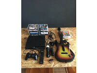 PS3 console bundle + 22 games + Guitar Hero + Playstation Move + Controller