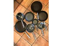 Anolon used 8 piece pan set