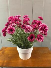 Artificial flower plant set in a pot