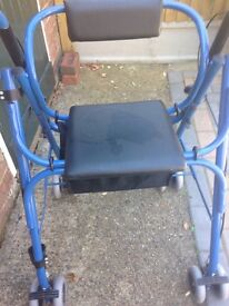 Wheelie with seat and shopping compartment £35