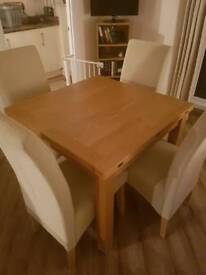 Light oak extending dining table a four high back chairs