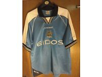 Collection of Manchester City football shirts size large