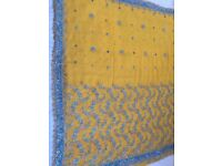 Yellow saree with turquoise work