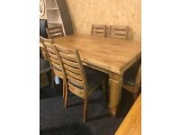 New oak dining table and six oak chairs,,leather seats
