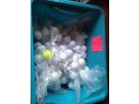Box full of golf balls