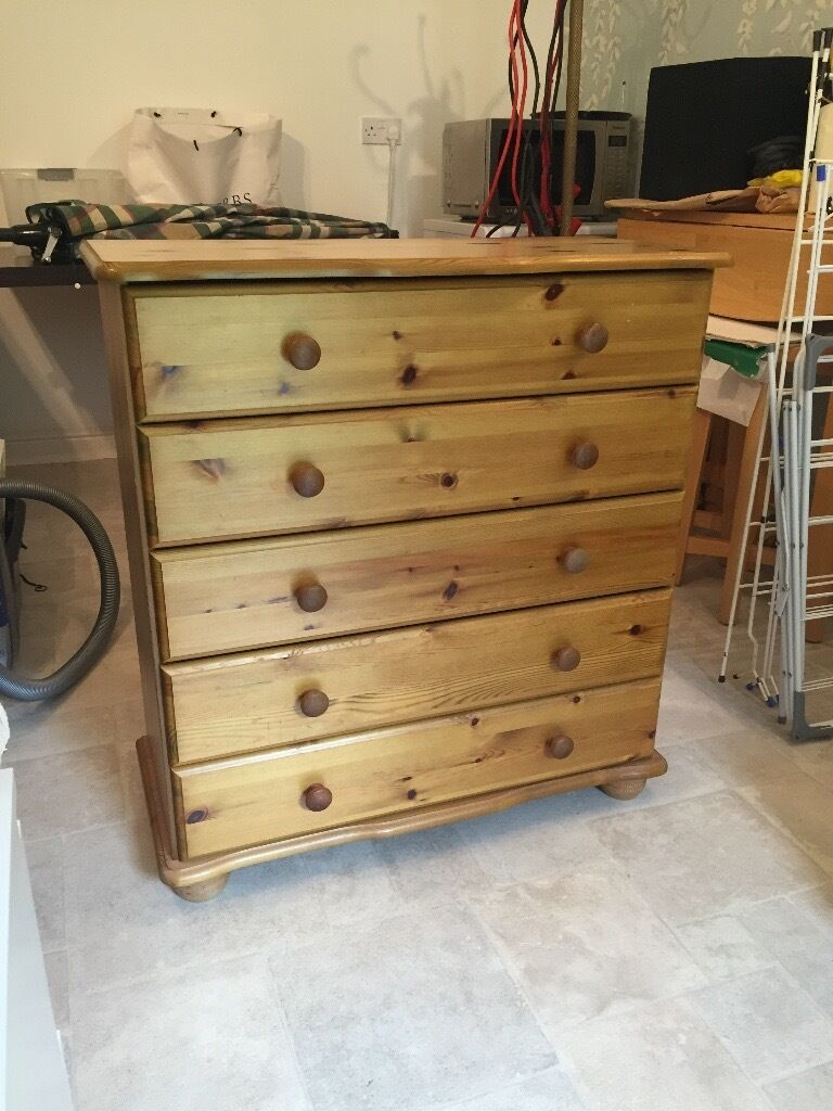 Pine 5 drawer chest of drawersin Balderton, NottinghamshireGumtree - Pine chest of drawers with 5 equal depth drawers. Satin finish. H 90cm, W 84cm, D 38cm. Pine top, bottom and sides and pine knobs on each drawer. Good condition. Buyer collect