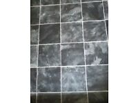 Grey slate tile effect vinyl.