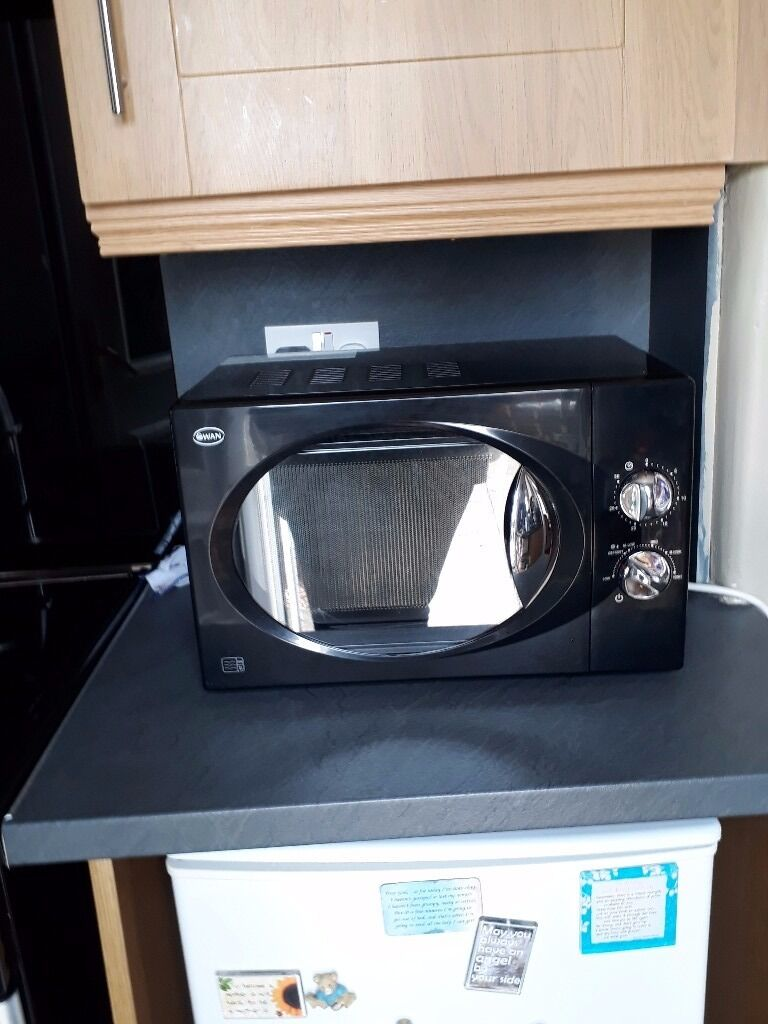 SWAN BLACK MICROWAVE (800WATTS) IN GOOD CONDITION AND CLEANin Knightswood, GlasgowGumtree - BLACK SWAN MICROWAVE 800 WATTS IN GOOD CONDITION.THIS MICROWAVE WOULD BE AN ASSET IN ANY ROOM IN YOUR HOUSE WORK ETC. BARGAIN AT ONLY £23.00.CAN DELIVER FOR SMALL FUEL FEE