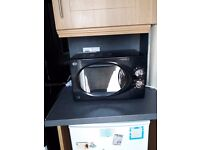 SWAN BLACK MICROWAVE (800WATTS) IN GOOD CONDITION AND CLEAN