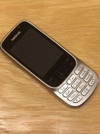 Nokia 6303 mobile phone with charger , USB connector , earphones and instructions