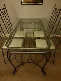 Glass Dining table and 4 matching chairs