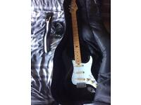 Electric guitar with cable, case, wall mount and a strap