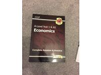 A-Level Year 1 + AS Economics Revision guide (CGP)