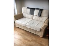 Wicker sofa in great condition with soft cushions. Perfect for kitchen / conservatory