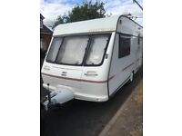 2 BERTH FLEETWOOD CARAVAN WITH MOTOR MOVER AND AWNING
