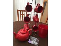Red tea pot and mugs