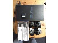 Play Station 2 + 2 pads + memory card + games