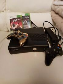 Xbox 360 slim with 2 controllers
