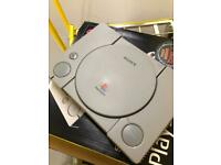 Sony PlayStation 1 (SCPH - 1002) along with over thirty accompanying games for sale.
